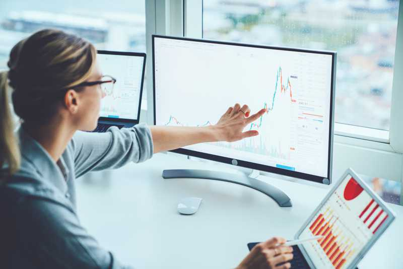 stock-photo-business-woman-study-financial-market-to-calculate-possible-risks-and-profits-female-economist-1204727542