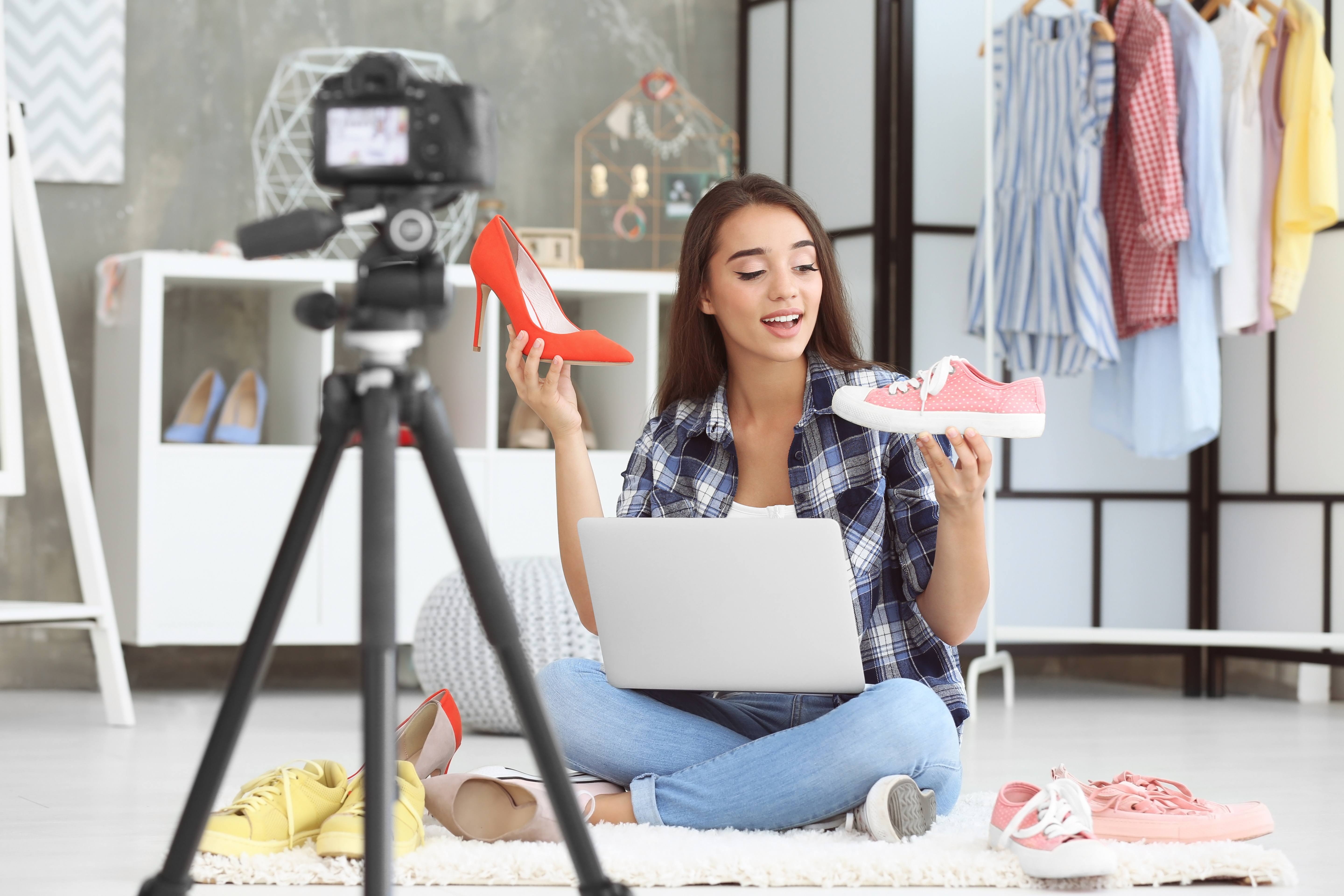 stock-photo-young-female-blogger-with-shoes-recording-video-at-home-720842107